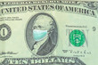Alexander Hamilton with Surgical mask on United States ten-dollar bill, 2019 series. Business concept of Covid 19 virus pandemic in United States. Covid-19 Coronavirus outbreak and the American crisis
