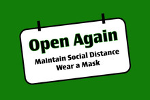 Black, Green White Open Again Sign While Maintaining Social Distance And Wear A Mask. Business, Health And Education Concept.