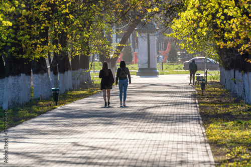 two girls takes a walk by allay Canvas Print