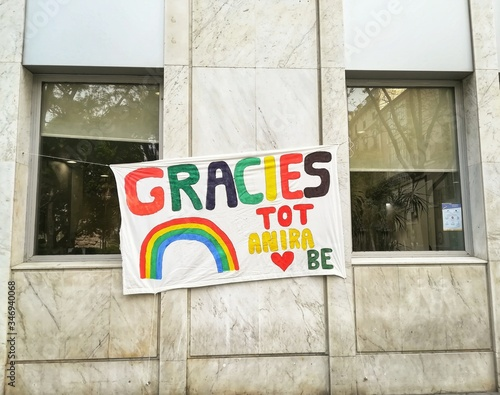 Photo Sign during the quarantine in coronavirus crisis with the rainbow and  Text in catalan: Thanks, Everything will be allright