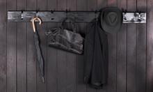 Coat On A Black Wooden Hanger ...