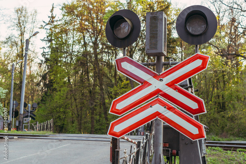Valokuva Road sign. Iron level crossing without a barrier.