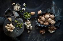 Tray And Bowls Of Various Nuts