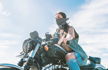 Young Beautiful Woman Riding Motorbike