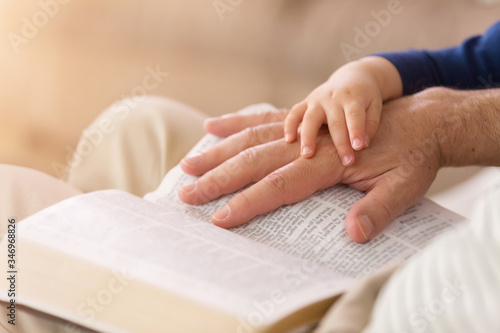 Leinwand Poster Grandpa Reading to Baby Boy From the Bible