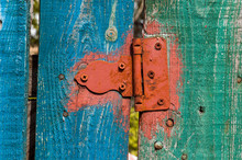 Rusty Hinge On A Painted Timbe...
