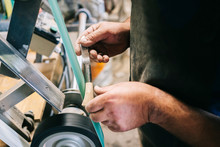 Craftsman Working On Knive In ...