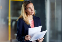 Businesswoman Holding Papers I...