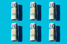 Twenty Euro Rolled Banknotes Pattern On A Blue Background