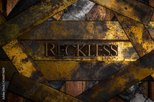 фотографія Photo of real authentic typeset letters forming Reckless text on vintage texture