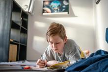 Portrait Of Drawing Boy Lying ...