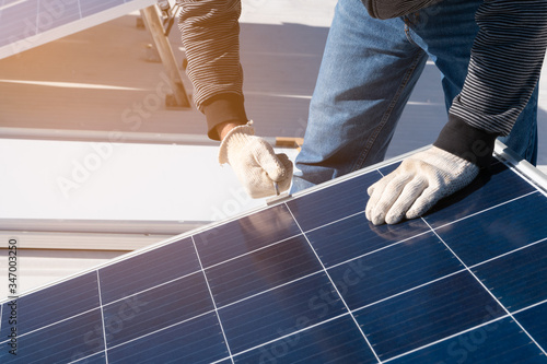 Vászonkép operator installing solar equipment in residence