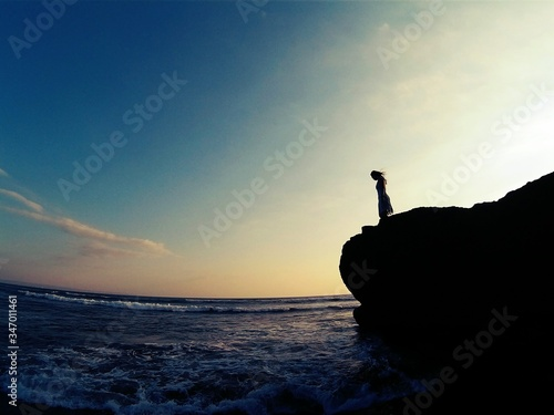 Fototapety, obrazy: Woman Standing On Cliff By Sea Against Sky