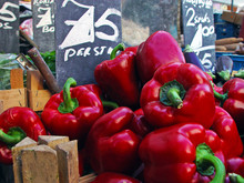 Close-up Of Red Bell Peppers For Sale In Market