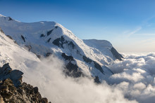Clouds And Fog Near Dome Du Gouter And Bosson Glacier Mont Blanc Massif In The French Alps. View From The Cosmique Refuge, Chamonix, France. Perfect Moment In Alpine Highlands.