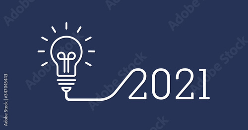 Photo Creative light bulb idea with 2021 new year design with a light-bulb on the Dark Blue background color