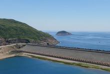 High Island Reservoir Dam Site With Huge Hexagonal Columnar Joints Of Volcanic Rock At Hong Kong Global Geopark, China