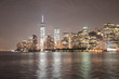 One World Trade Center Against Sky By River In Illuminated City At Night
