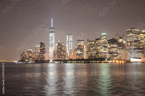 Fototapety, obrazy: One World Trade Center Against Sky By River In Illuminated City At Night