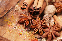Fragrant Spices On A Wooden Background