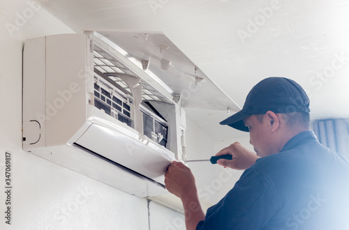 technician working service  air conditioner inroom Canvas Print