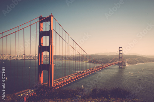 Leinwand Poster Golden Gate Bridge Over Bay Against Sky