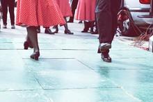 Low Section Of Men And Women Dancing On Floor