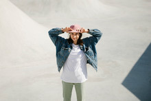 Young Smiling Woman Standing I...