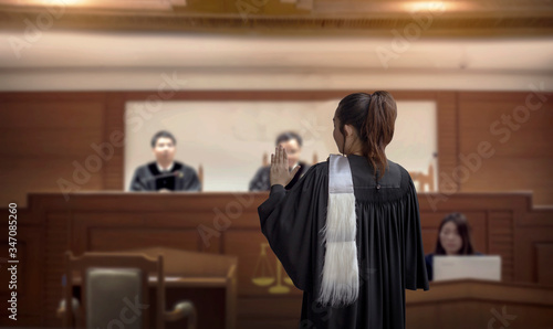 Obraz court room woman lawyer talk to attorney and  magistrate in trail court room o in feminine legal judgment  - fototapety do salonu
