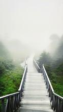 Empty Footbridge During Foggy ...