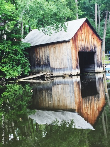 Boathouse Reflection In Lake By Trees Fototapete