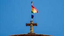 Flag Of Cusco. Rainbow Flag On Top Of A Church
