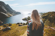 Woman traveler walking alone enjoying sea view outdoor travel summer vacations healthy lifestyle girl with backpack in Norway