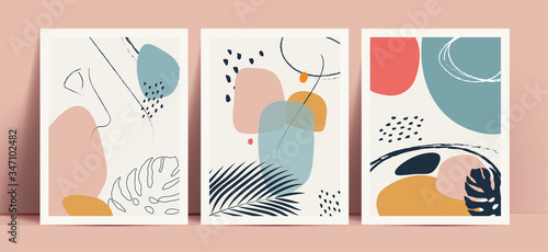 Abstract terrazzo style background set with pastel color hand drawn geometric shapes and lines and tropical leaves silhouettes. Works for decor wall prints or book cover or flyer or menu design. © paul_craft