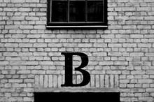 Close Up Of Wall With Letter B