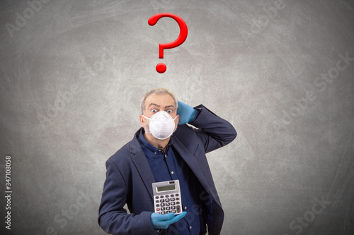 Fototapeta adult business man with calculator and face mask question marks isolated on background obraz