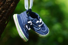 Close-up Of Shoes Hanging On Tree Trunk