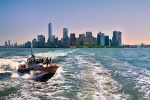 Manhattan Cityscape With Ocean Views And Coast Guard In The Foreground