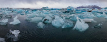 Panoramic View Of Icebergs In Sea Against Sky