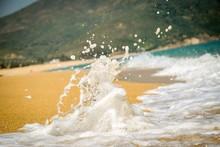 Close-up Of Waves Splashing On Shore