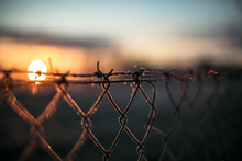 Close-up Of Barbed Wire During...
