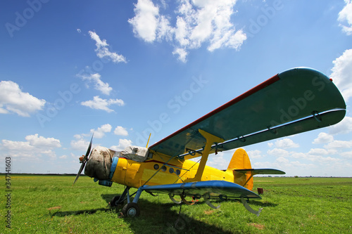 Crop duster airplane on airfield Wallpaper Mural