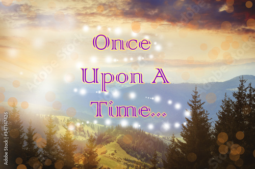 Beautiful mountain landscape with magic lights and text Once upon a time. Fairy tale world