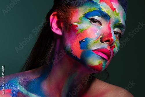 Fototapeta Face art and body art. Creative makeup with colorful patterns on the face. Modern makeup art, bold style, obraz na płótnie