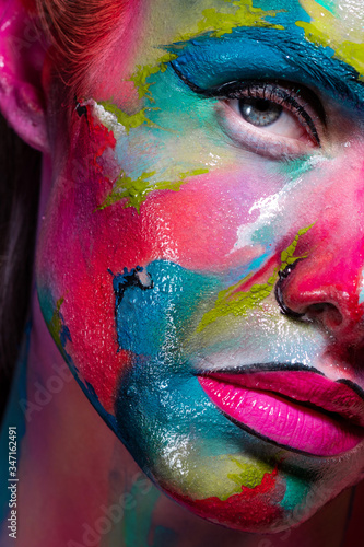 Fototapeta Multicolored skin, difficult to identify. Creative makeup with colorful patterns on the face. obraz na płótnie