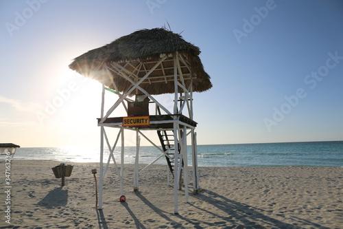 Fotografiet Lifeguard Hut On Beach Against Clear Sky