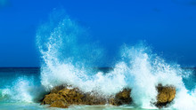 Water Splashing In Sea Against Clear Blue Sky