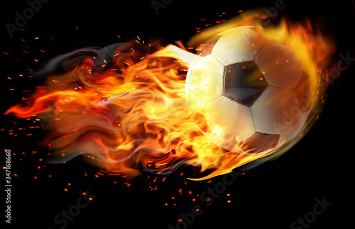 Soccer ball with bright flame flying on black background