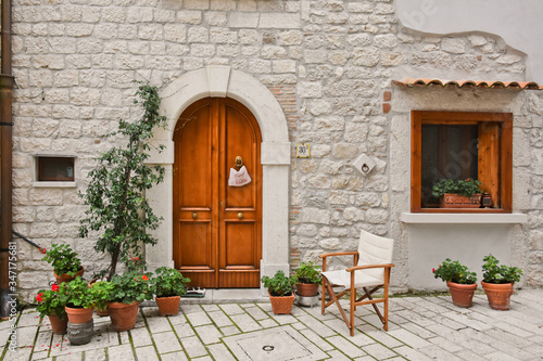 A narrow street between old buildings in the medieval town of Cusano Mutri, in t Canvas Print