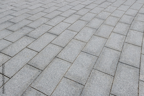 A pavement made of rectangular stone slabs.